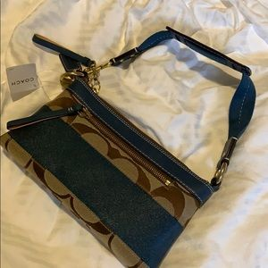 Tan and blue small coach purse